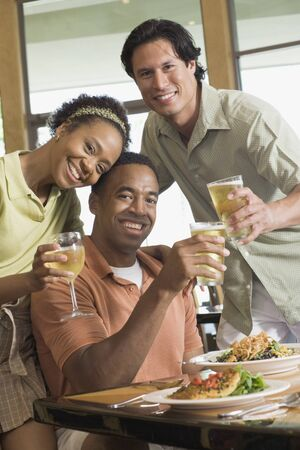 Multi-ethnic friends drinking at restaurant Stock Photo - 16092836