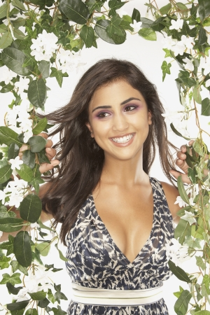 unconcerned: Middle Eastern woman standing in potato vines