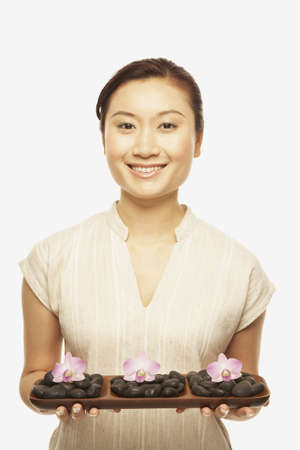Asian woman holding spa treatment tray Stock Photo - 16092781