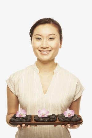 Asian woman holding spa treatment tray Stock Photo - 16092781
