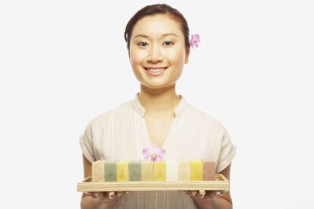 Asian woman holding tray of soap Stock Photo - 16092868
