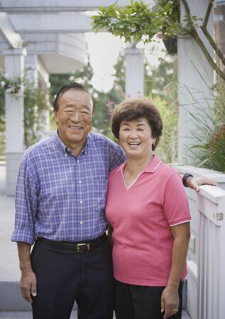 Portrait of senior Asian couple outdoors