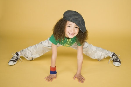 Portrait of young girl doing splits
