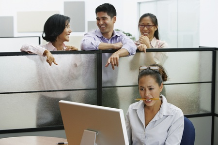Asian businesspeople pointing at businesswoman Stock Photo - 16092929