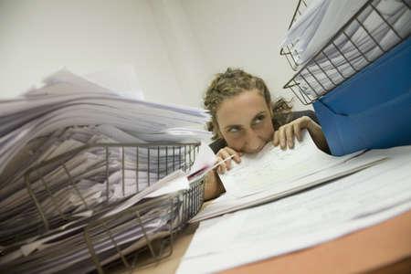 Hispanic businesswoman biting paperwork Stock Photo - 16092964