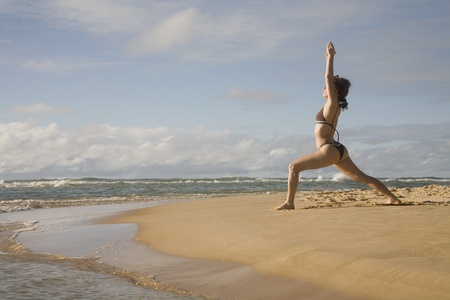 Woman practicing yoga on beach Stock Photo - 16092965