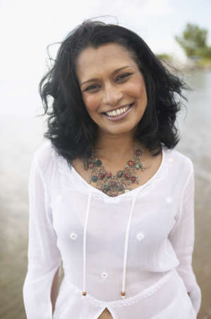 relishing: Close up of Indian woman smiling outdoors LANG_EVOIMAGES