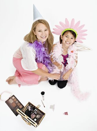 Studio shot of mother and daughter playing dress up  Stock Photo