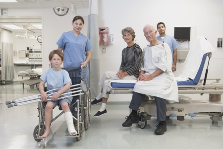 hindering: Healthcare professionals and patients posing in hospital setting