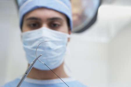 Close up of Indian male surgeon with surgical needle Stock Photo - 16093134