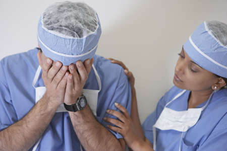 job loss: Indian female doctor consoling male doctor