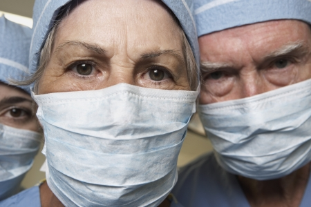 Close up of senior male and female doctors in surgical masks 스톡 콘텐츠