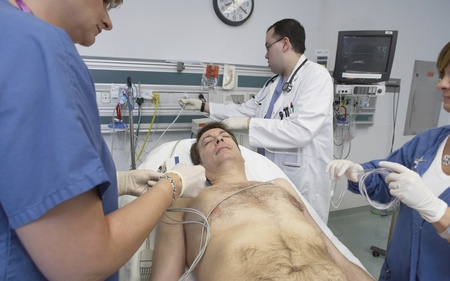 Doctors working on male patient in hospital Stock Photo - 16093157
