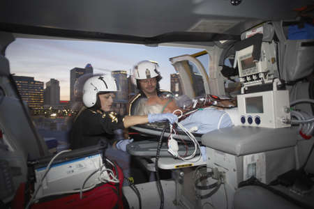 Doctors with patient in medical helicopter