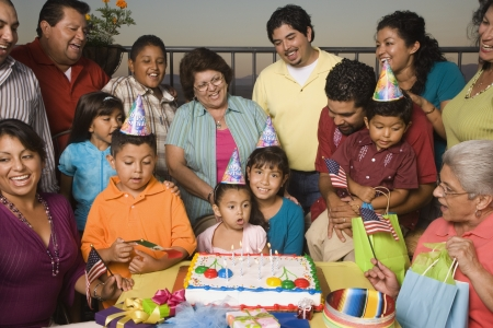 Large Hispanic family celebrating birthday