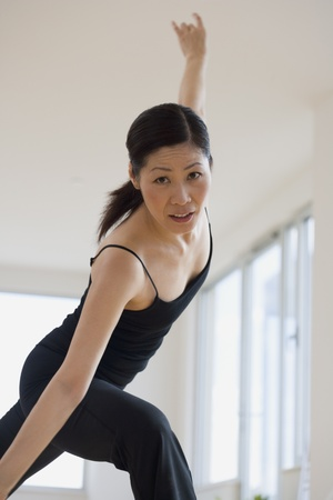 Middle-aged Asian female dancer practicing Stock Photo - 16093194