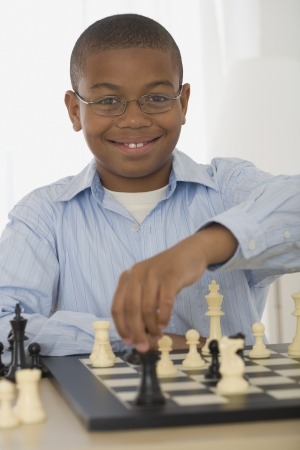 African boy playing chess 스톡 콘텐츠