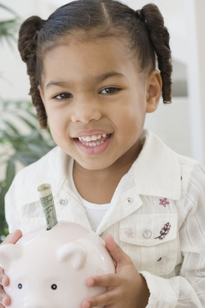 dollarbill: African girl holding piggy bank