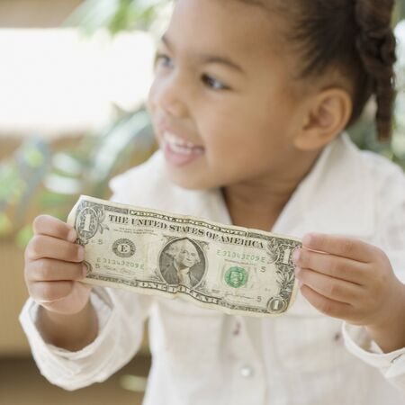 dollarbill: African girl holding dollar bill