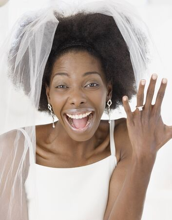 African bride showing off ring
