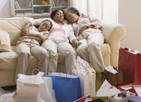 three generations of women: Three generations of African women resting on sofa