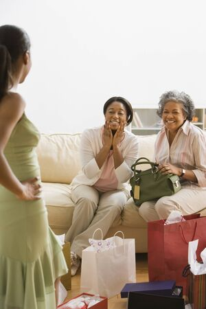 African girl modeling new dress for mother and grandmother Stock Photo - 16093254