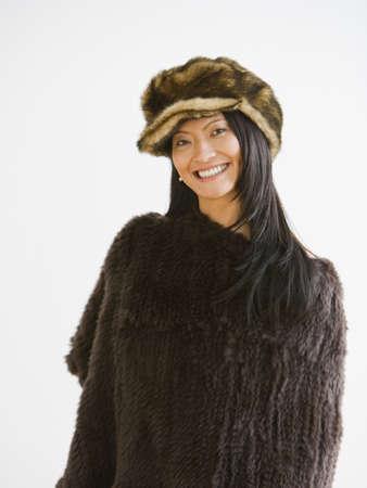 Studio shot of Asian woman wearing fur hat Stock Photo - 16093259
