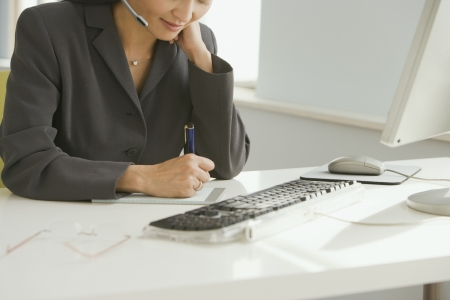 adult  body writing: Asian businesswoman working at desk