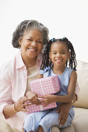 African grandmother and granddaughter hugging Stock Photo - 16093272