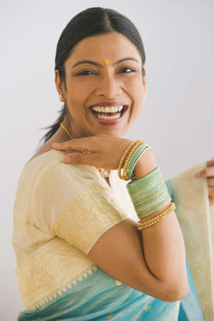 relishing: Indian woman in traditional clothing smiling