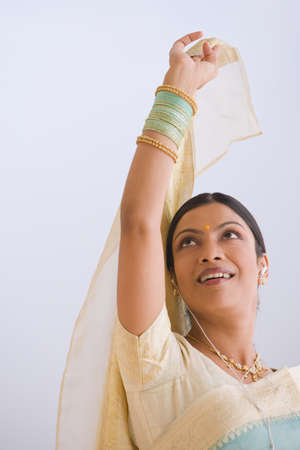 relishing: Indian woman in traditional clothing