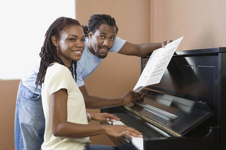 African couple playing piano Stock Photo - 16093314