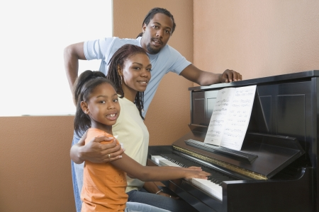 African family playing piano Stock Photo