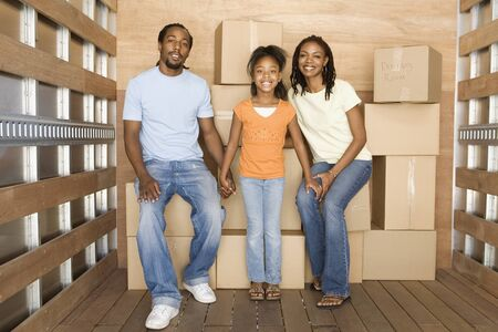 moving truck: African family in back of moving truck