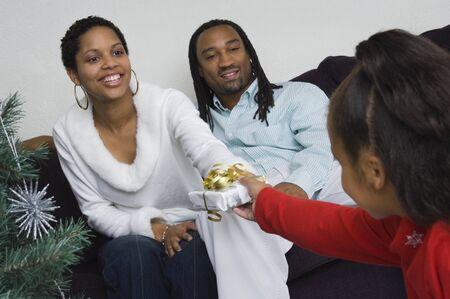 African family exchanging gifts at Christmas Stock Photo - 16093345