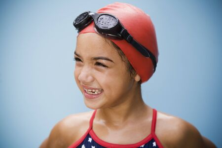 Hispanic girl in bathing suit with goggles and swim cap Stock Photo - 16093357