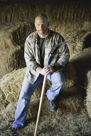 Portrait of male farmer in hay barn Stock Photo - 16093374
