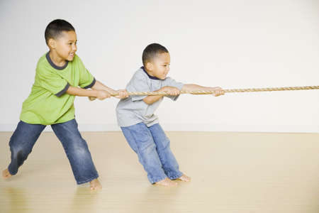 tugging: African brothers playing tug of war