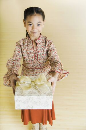 pacific islander: Portrait of Pacific Islander girl holding gift
