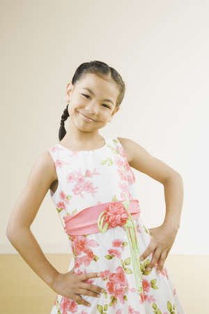 pacific islander: Portrait of Pacific Islander girl with hands on hips LANG_EVOIMAGES