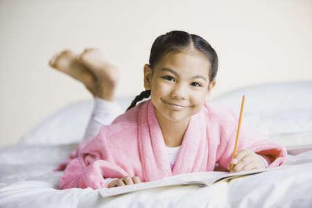 pacific islander: Pacific Islander girl writing in notebook