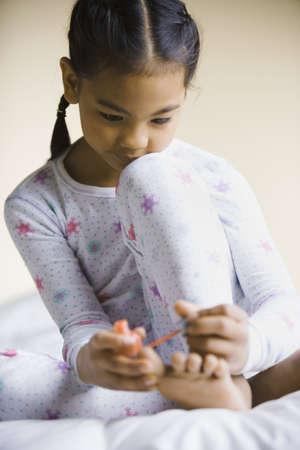 pacific islander: Pacific Islander girl painting toenails