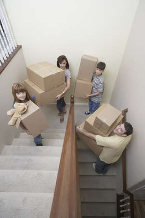 Family carrying moving boxes up stairs Stock Photo - 16093539