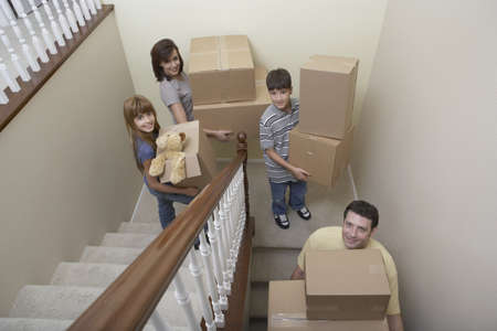 Family carrying moving boxes down stairs Stock Photo - 16093549
