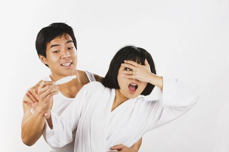 Asian couple looking at pregnancy test