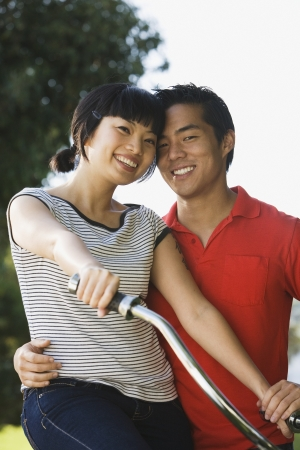 Portrait of Asian couple hugging Stock Photo - 16093592
