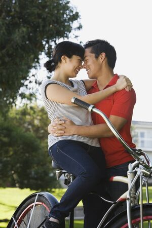 Portrait of Asian couple hugging Stock Photo - 16093593