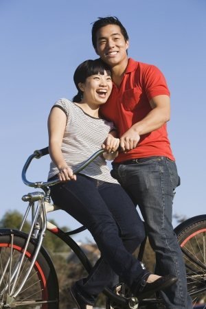 Portrait of Asian couple on bicycle Stock Photo - 16093594
