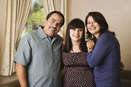 hispanic ethnicity: Portrait of Hispanic family hugging LANG_EVOIMAGES
