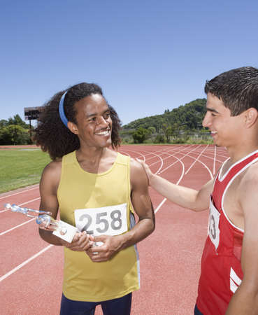 foe: African male runner being congratulated on track